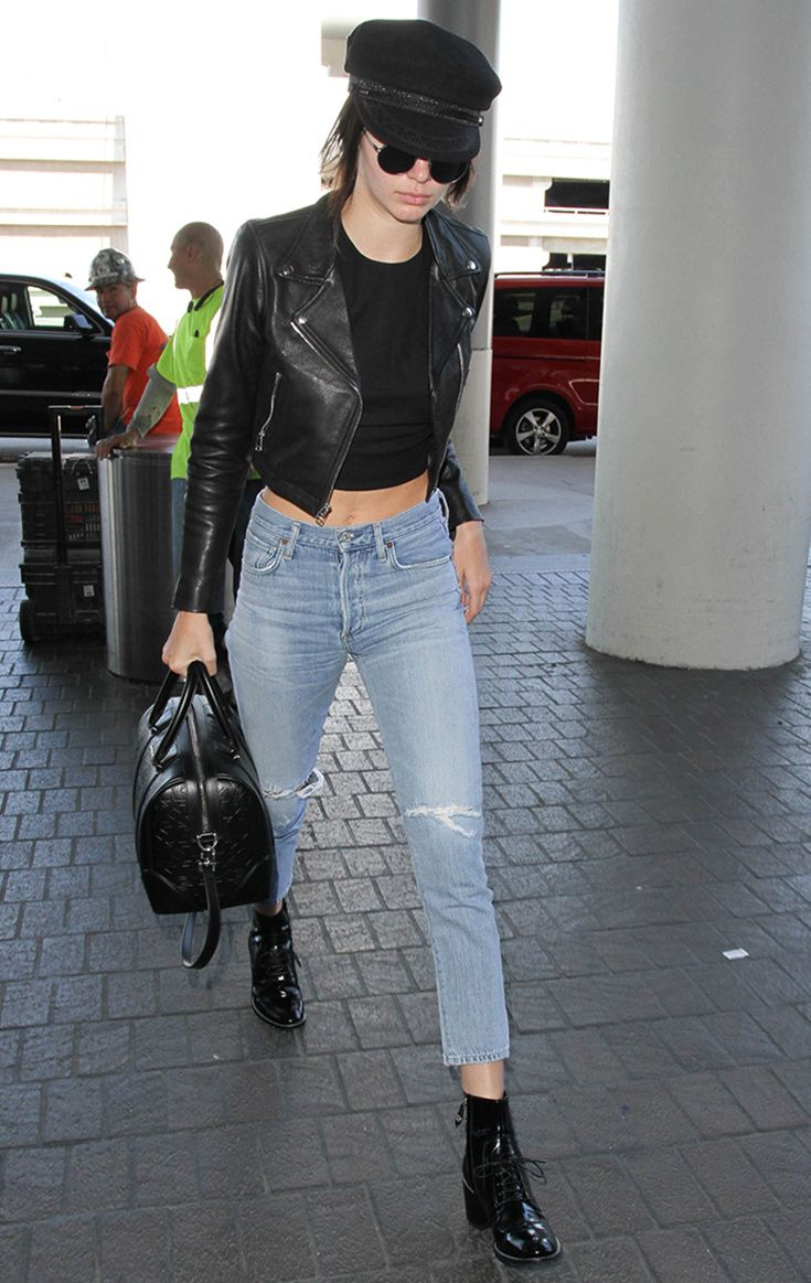 Kendall Jenner does airport chic in Citizens Of Humanity denim jeans, black patent boots and a cropped leather jacket by Laer, complete with baker boy cap.
