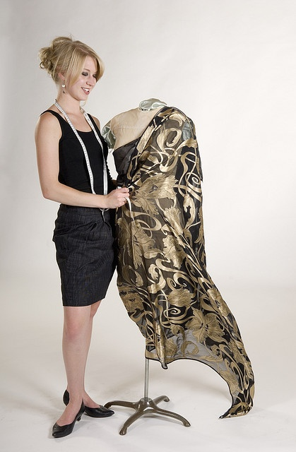 Fashion designer in black tank top and skirt works on a project with vintage mannequin     Some of the fresh fashion pictures I found.   If  You are interested in  fashion courses here is something interesting http://fashiondesigncourse.easy2u.eu