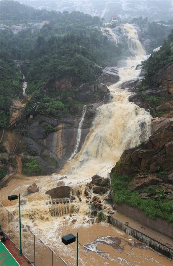 A road is engulfed by water and rocks after a landslide on June 18, 2012 in Wenzhou, China. Heavy rainstorms hit east China's Zhejiang province on Monday, causing flooding in low-lying areas across the region.