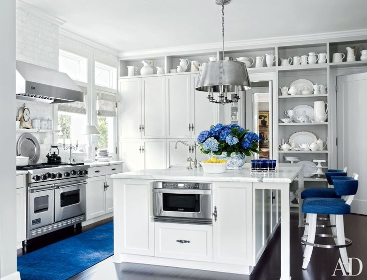 Clean whites with pops of #blue.  Beautiful. Traditional Kitchen in Los Angeles, California: Blue Accent, Open Shelves, Kitchens Design, Lucky Branding, Traditional Kitchens, The Angel, Blue Kitchens, Patrick'S Wade, White Kitchens