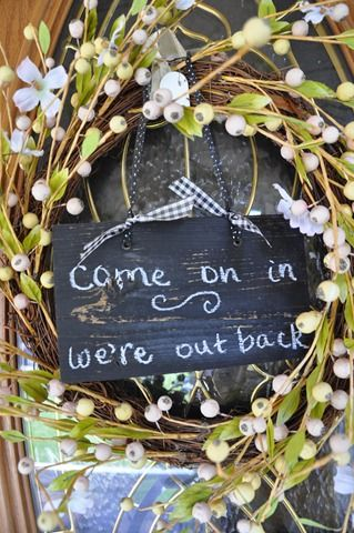 Sign on front door wreath for backyard parties.    Or come join us, we're out back if you don't want guests inside