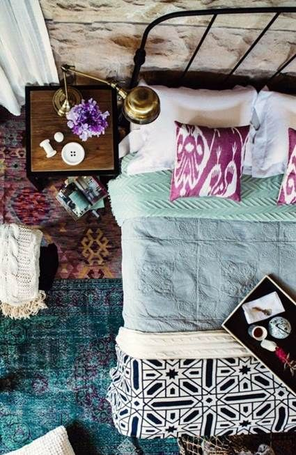 layers of colors and textiles in the bedroom