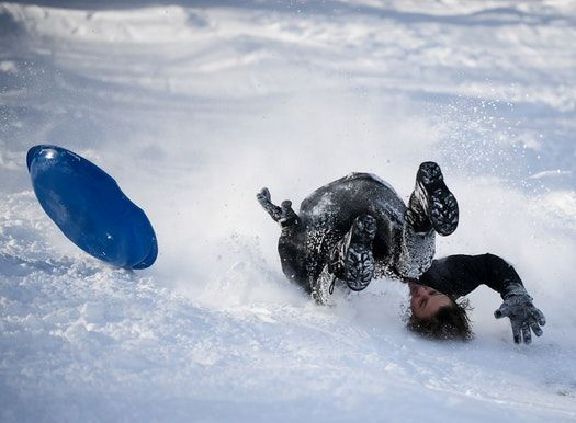 Bobby Wiesner, 15, a student at Southwest High School, was upended as he sledded down the hill at Beard's Plaisance Tuesday.