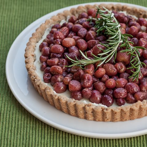 Layered over sweet mascarpone cream in a brown sugar-pecan crust, roasted grapes look and taste quite elegant. This roasted grape tart is simple to prepare.