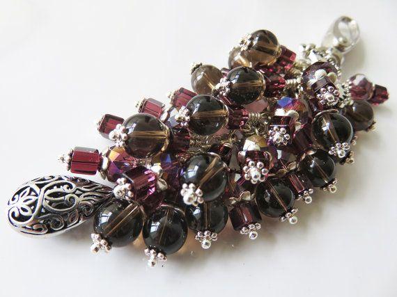 Check out this item in my Etsy shop https://www.etsy.com/uk/listing/482081431/black-and-purple-bag-charm-smokey-quartz