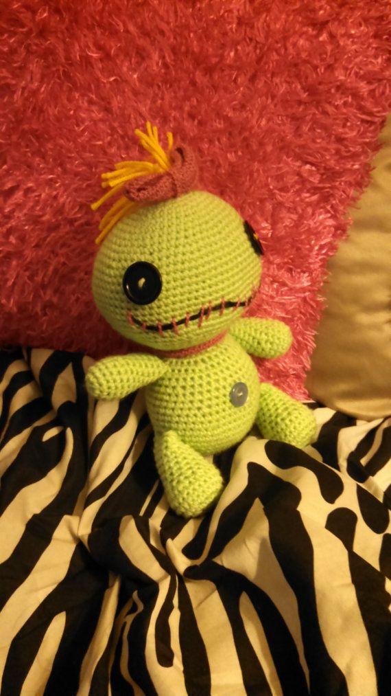 This is a crocheted Scrump doll. Scrump is Lilos doll from Lilo and Stitch. Scrump is approximately twelve inches tall. She is a soft, yet