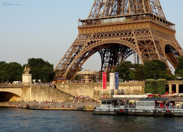 The Eiffel Tower as seen from across the River Seine, where the size of the structure is put into perspective to the tourists below. Related information www.eutouring.com/images_eiffel_tower.html