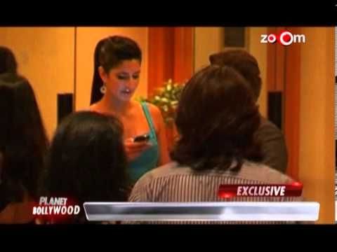 trina's cell phone keeps her busy at a party-Bollywood India