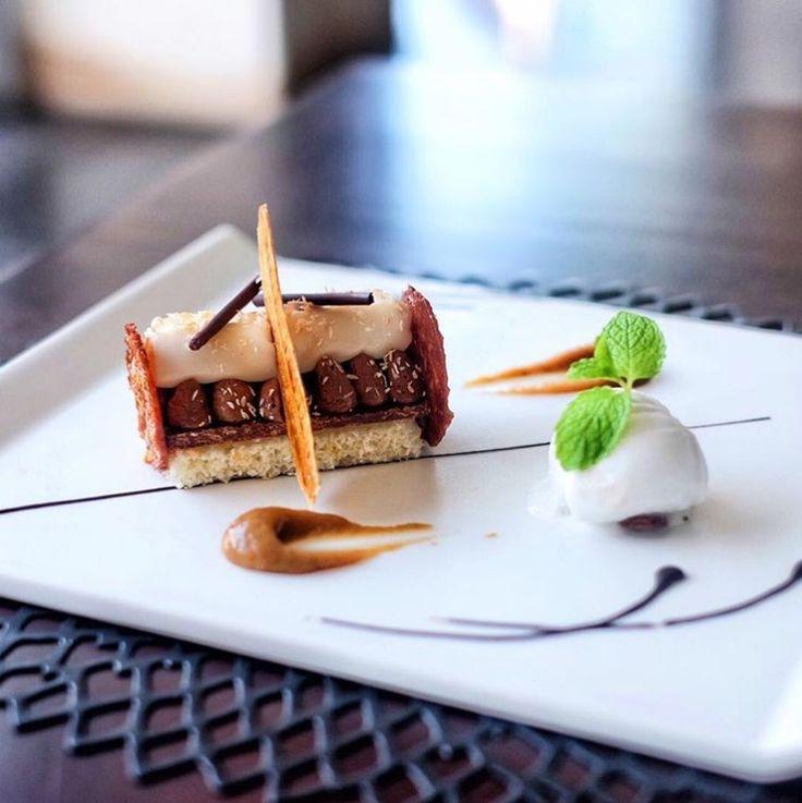 "Raise your hand if you love desserts! We do! Enjoy our signature coconut dessert ""Bounty"" at #SakalaBeachClub !  #TheSakalaResortBali #SakalaBeachClub #SakalaBali Picture by: @nomnombali"
