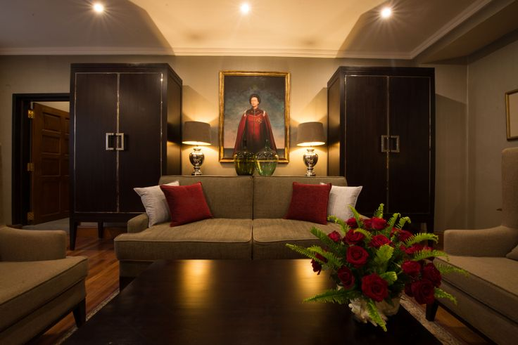 The new Queen Elizabeth II Suite.  Accent colours and fresh flowers complete this elegant space.
