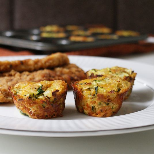 Zucchini Tots -- Ingredients include zucchini, egg, onion,  grated cheese, dry breadcrumbs, salt and paper -- No potatoes! Made in mini-muffin tin.