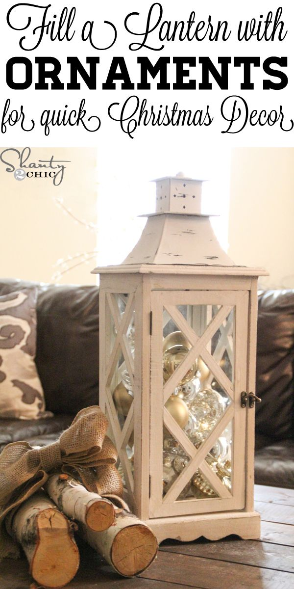 Easy and quick Christmas Decor! Just fill a lantern up with ornaments. So copying this!