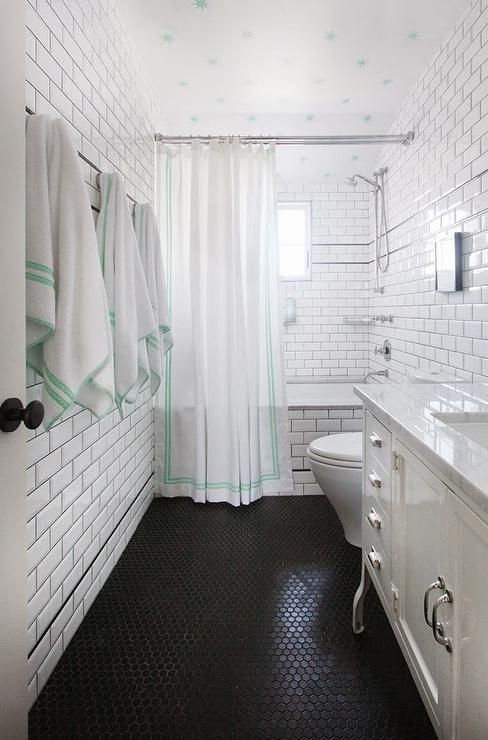 Inspiration Web Design Black and white kids u bathroom with green accents features ceiling clad in Coronata Star Wallpaper over walls clad in white subway tiles lined with a row of