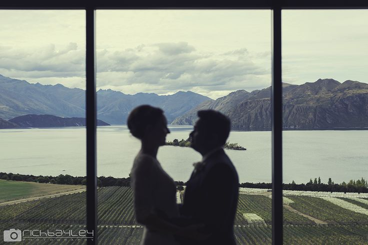 Newlyweds in front of the main window at The Rippon Hall.