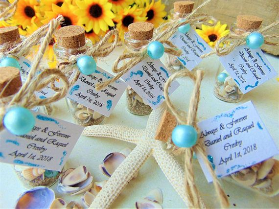 "Beach Wedding Favors,Message in a bottle,nautical favors,beach in a bottle,sand,sea shells,personalised wedding gifts,personalised favors    Wedding favors Save the Date, Personalized party favors, Wedding favors for guests,Wedding thank you gift for guests,Message in a bottle    🔆🔆🔆Looking for unique wedding favor?       Always and Forever ~ Beach in a bottle wedding favors!        These little bottles are the perfect wedding favors for your guests at your wedding, bridal shower, wedding party, birthday party.  With purchasing this listing you will receive the favors completely assembled and ready for your guests!    Customization:    You can create a unique message special to you with at least 1- 39 letters!    When purchasing, please let me know your names and wedding date!     Example:    Always & Forever  Daniel and Raquel           Crosby  April 1st, 2018      Bottles are filled with sand, sea shells, snails! Little tag has been attached to the bottle!   Adorned with twine to a ribbon and cute little light blue pearl!            Measures of the bottle approximately :     2"" x 0.7 with the cork or 5.5 cm in height, 2 cm wide      All orders are packaged with care and safely delivered!      Processing time your order: 1-2 weeks!   Contact us before purchase if you need it fast!        Estimated shipping time:    United States: 10-25 business days  Canada: 10-30 business days  United Kingdom: 7-21 business days  Australia, New Zealand and Oceania: 10-21 business days  Europe: 7-14 business days        * Note that a signature will be required for package delivery.  * Custom or personalized orders are non-refundable.  * Please double check your shipping address.     We cannot be held responsible for items shipped to an incorrect address.        Please do not hesitate to contact us if you have any questions! :)      ...Because you are so special !!!! 