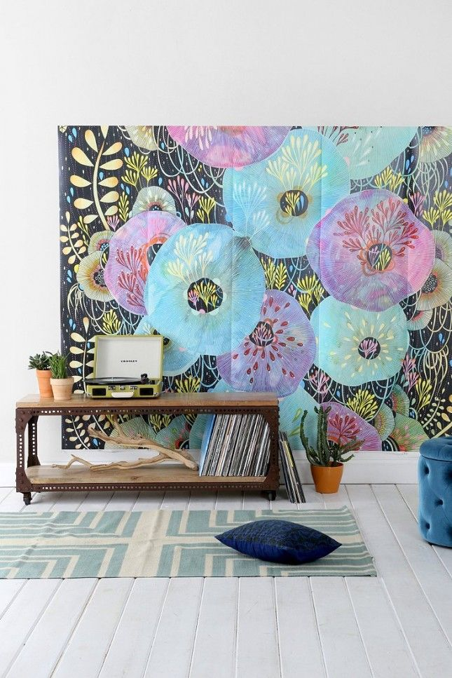 How fun are the colors in the vivid, floral mural?