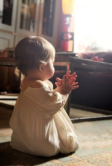 In my mind... I feel this baby is seeing an angel and has the hands together for praying just like the angel is showing......     Such a precious pic!!     Aline ♥