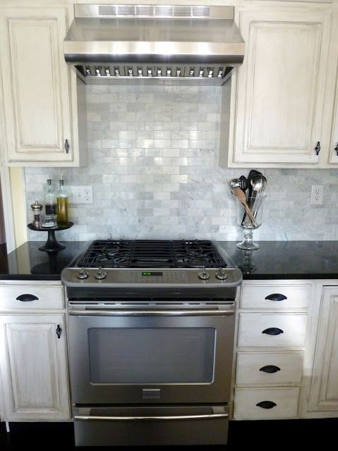 2x4 Marble Look Backsplash Dark Counters White Cabinets