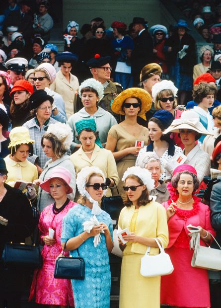 Australian fashion history Racegoers at Randwick Raceourse on Melbourne Cup Day (ca. 1965). It was an era of colourful but conservative fashion in Australia. British model Jean Shrimpton caused quite a stir in the same year when she turned up at Flemington racecourse with a skirt 7.5cm above the knee.  Photo Credit: David Moore/State Library of NSW