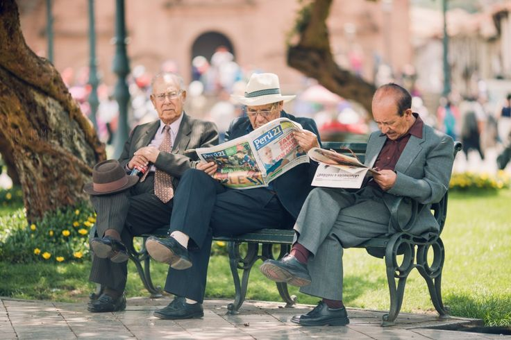 People are the same no matter what country you're in. These men sat in a plaza in the middle of a parade in Cuzco Peru, reading the newspaper before work.