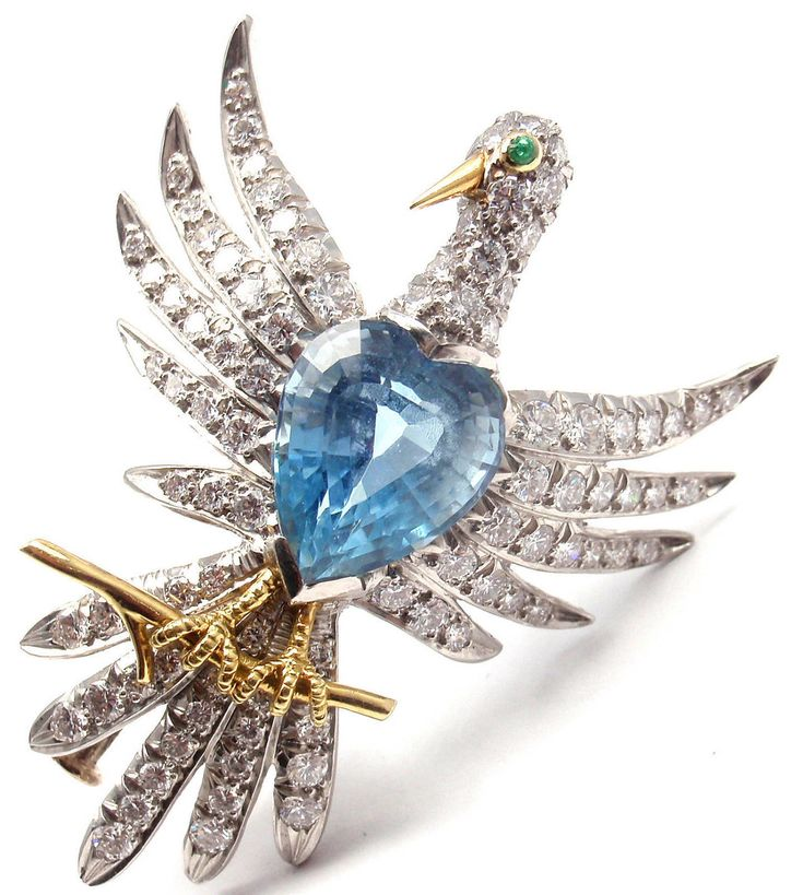 Schlumberger for Tiffany & Co. Phoenix Bird Diamond Aquamarine Platinum Pin. Platinum Diamond Aquamarine Phoenix Bird Brooch/Pin by Jean Schlumberger for Tiffany & Co. With 89 round brilliant cut diamonds VS1 clarity, G color total weight approx. 1.7ct 1 aquamarine 12mm x 10mm approx. 7.85ct 1small round emerald, c 1979