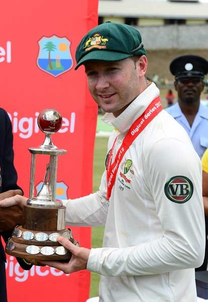 Australian captain Michael Clarke receives the trophy after his team won the third test match between the West Indies and Australia in Roseau on April 27, 2012. Australia won by 75 runs and won the three test series 2-0.