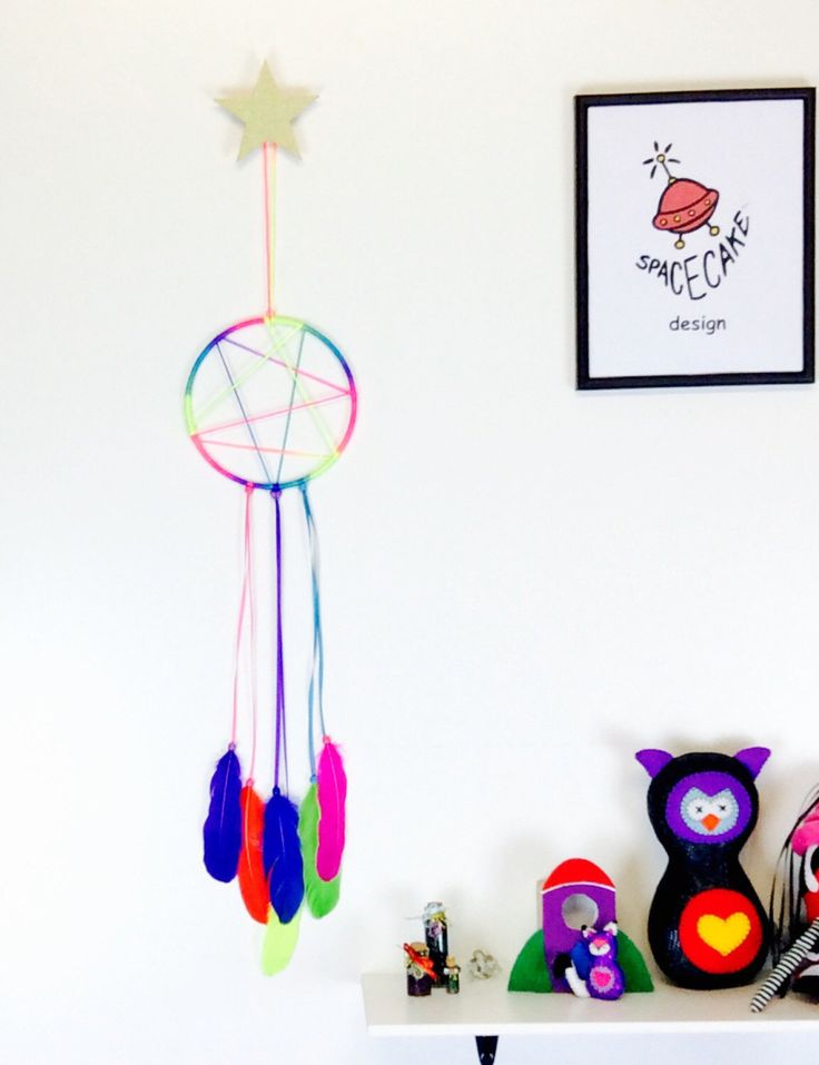 A personal favourite from my Etsy shop https://www.etsy.com/au/listing/473107213/dream-catcher-colourful-rainbow-wall