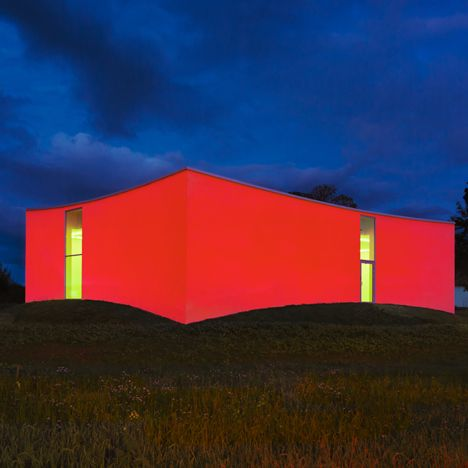 This glowing gallery by sits on a hill  gives the illusion of concave walls.