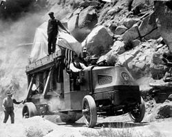 The Hale 100-inch mirror for Mount Wilson Observatory on its way up the Mount Wilson Toll Road on a Mack Truck in 1917.