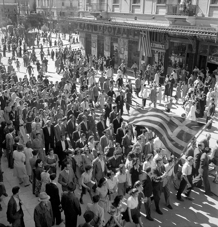The people of Athens, Greece celebrate the liberation of Greece from Nazi German occupation, Oct 1944. Within two months, Athens had been turned into a battlefield as communist guerrillas tried to establish a Soviet-controlled regime and battled British and Greek forces. The battle ended in late Jan 1945. A large part of central Athens was devastated.