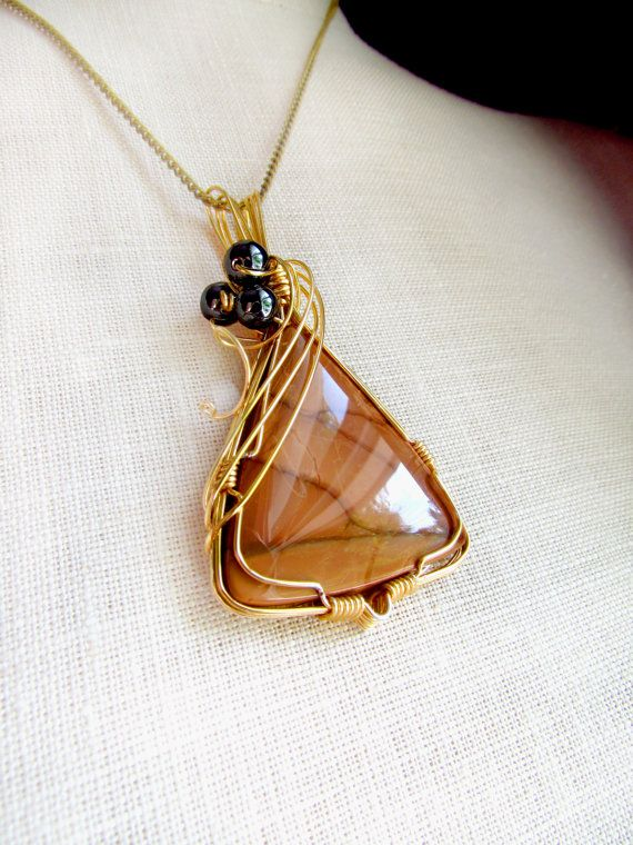 Bruneau Jasper triangular cabochon wire wrapped in golden German style wire, tan pendant with Hematite healing beads