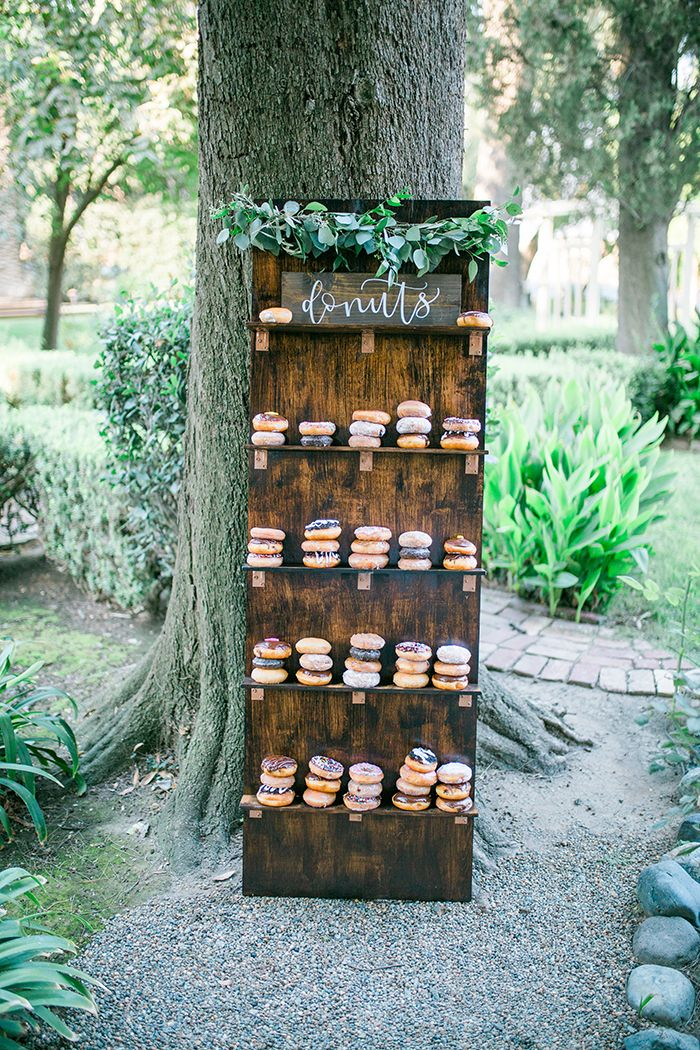 Barn Wood Donut Display for a Ranch Chic Wedding  https://heyweddinglady.com/modern-ranch-chic-northern-california-wedding/    #wedding #weddings #weddingideas #engaged #realweddings#weddingday #ranchwedding #rusticwedding #bohemianwedding #donuts