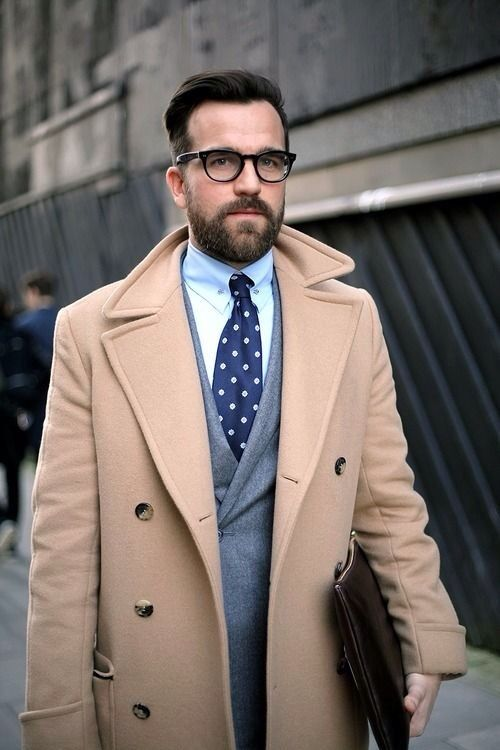 Tan men's peacoat with subtle contrasting colors in the tie, vest and dress shirt.