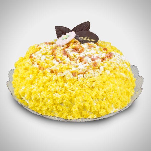 Mimosa - Soffice pan di Spagna farcito con una deliziosa crema al cioccolato, pezzetti di ananas fresco, e panna montata. Un dolce fiore!