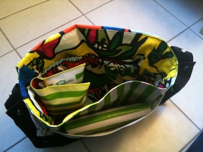 Oilcloth nappy bag with a nappy wallet inside and a change mat folded into the pocket at the front of the bag. http://anna-banana.com.au http://etsy.com/shop/annabananafa