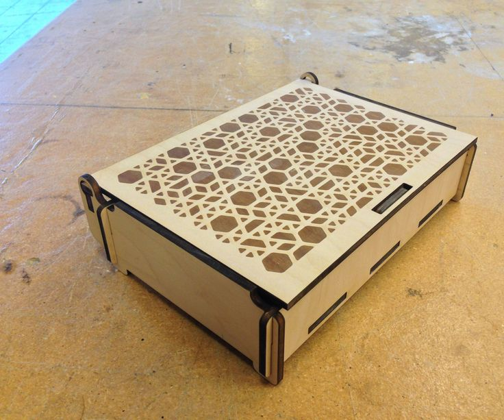 Hello! I'm going to show you how to build this simple wood box on a laser cutter. I designed this box for a specific purpose but it would work great as a jewelry box, a pencil box (without the divider) or to hold any other small knick-knacks. If you build more than one they will lock together as they stack and the lid will stay open on its own as you peruse its contents. I made mine using Techshop's Epilog 60 Watt Helix.