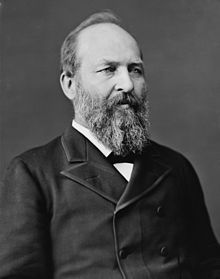 Garfield wears a double breasted suit and has a full beard and receding hairline. James A. Garfield was the 20th President and was in office March 4, 1881-September 19, 1881