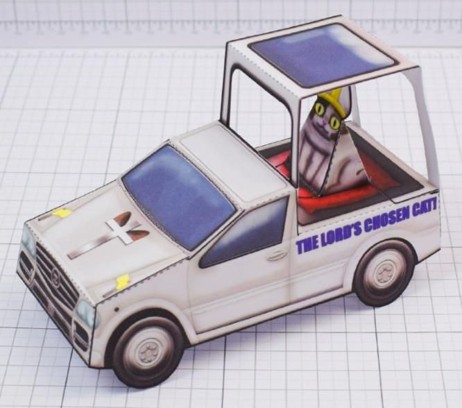Created by designer Alex Gwynne,  from Fold Up Toys website,  this is the paper toy  of the Creationist Cat  riding in a pope-mobile. Crea...