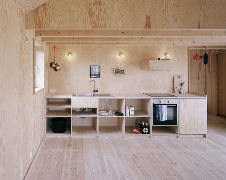 Plywood kitchen. This is the most horrible thing I've ever seen, so naturally I had to share. I would feel like I was trapped in a dollhouse....