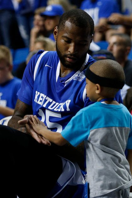 Demarcus Cousins and the cutest little kid i have ever seen.