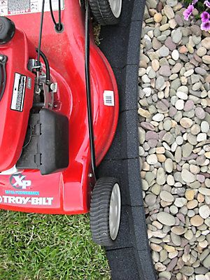 EcoBorder is molded from recycled tires, giving it the look of stone with the flexibility of rubber. Its trademark mower edge design eliminates the extra maintenance of string trimming. Will not heave or crack from root growth or seasonal changes in the ground. Beautifully textured, our EcoBorder is also mold and mildew resistant.