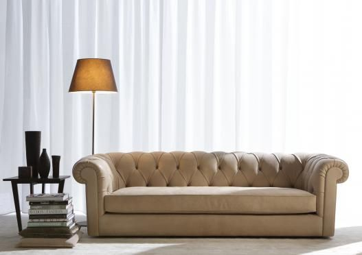 I love this sofa -- the creamy color and the size are just what I am looking for.  Boston Chesterfield Sofa