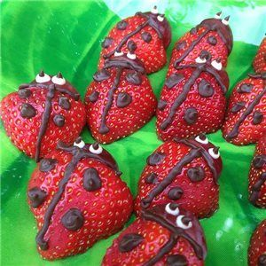 Strawberry Ladybugs: strawberry body, 1/2 of a grape for head, decorated with dark & white chocolate