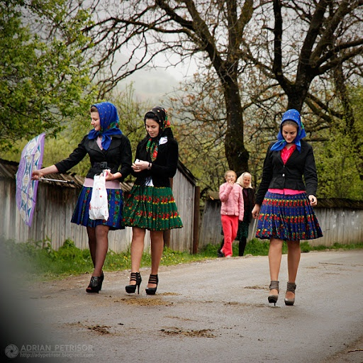 3 young girls geting ready for a village holiday. #Romanian national costumes