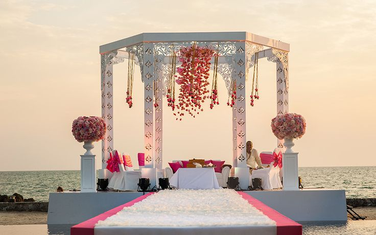 Flower chandeliers and a white mandap for Eisha and Sanjay's pheras