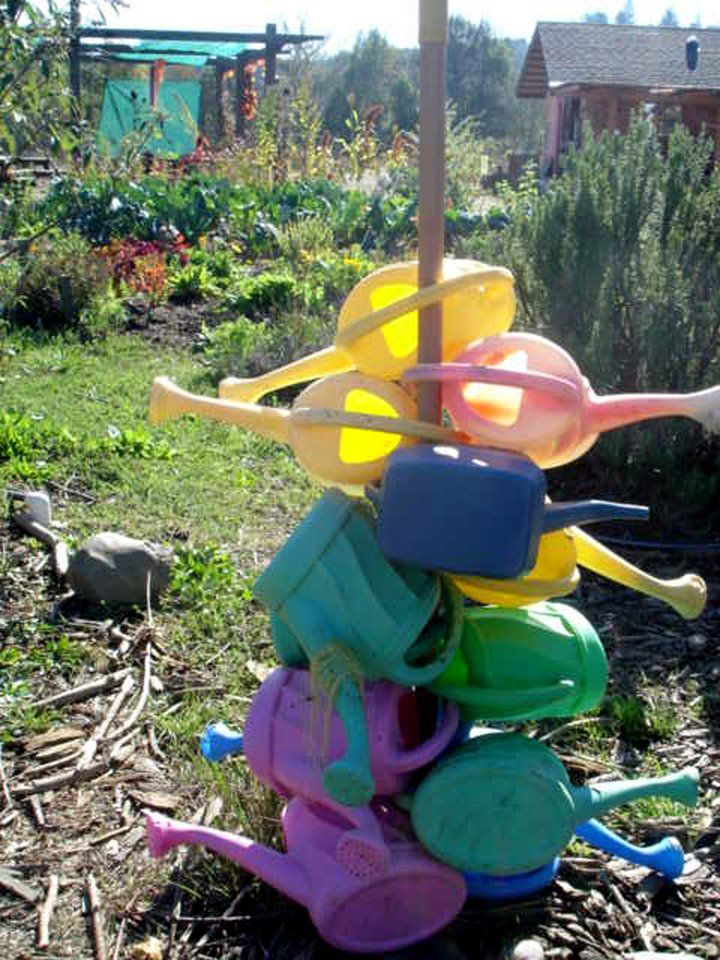 "Watering can station: position near a planting area. Great idea ("",)"