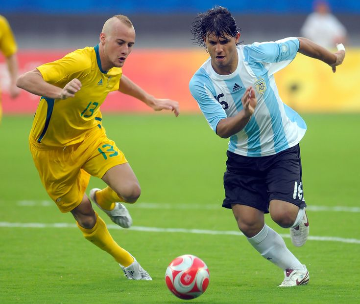 Sergio Aguero (R) of Argentina and Ruben Zadkovich of Australia compete for the ball during the Men's Group A match between Argentina and Australia on Day 2 of the Beijing 2008 Olympic Games on August 10, 2008 in Shanghai, China.
