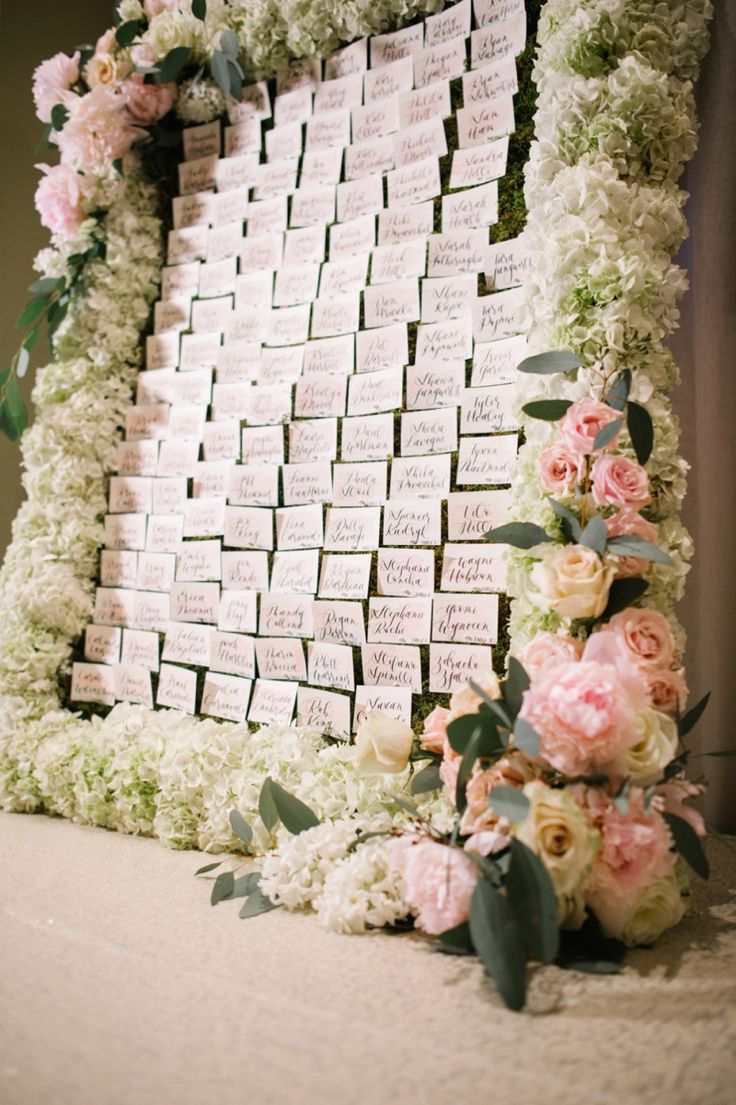 Unreal escort card display framed with flowers! | Corrina Walker Photography