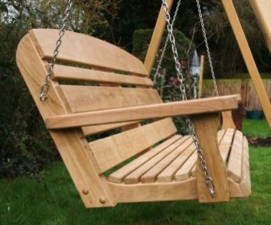 Horizon back design garden swing seat in English oak.