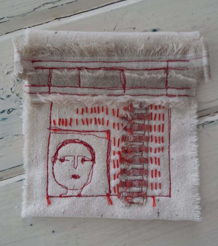 Hand stitching and machine stitching, layered raw silk and a striped scrap. It will be a neckpiece.